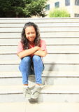 女孩坐的台阶 图库摄影