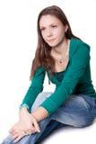 女孩坐 免版税图库摄影