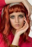 女孩塑料红头发人 图库摄影