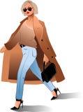 女孩太阳镜外套袋子时尚秀丽 图库摄影