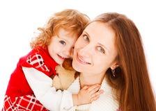 女孩她拥抱的妈妈 库存图片