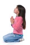 女孩她膝盖祈祷 免版税库存图片