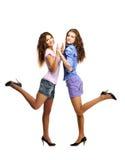 女孩嬉戏的二个年轻人 免版税库存照片