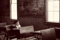 女孩学校坐的年轻人 库存照片