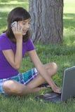 女孩学校技术使用 库存图片