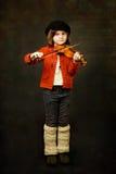 女孩实践的小提琴 图库摄影