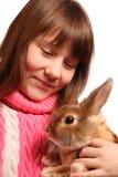 女孩宠物兔子 免版税库存图片