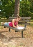 女孩室外公园设置 免版税图库摄影