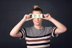 女孩对负纸与绿色美元的符号 免版税库存图片