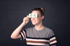 女孩对负纸与绿色美元的符号 免版税库存照片