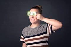 女孩对负纸与绿色美元的符号 免版税图库摄影