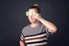 女孩对负纸与绿色美元的符号 图库摄影