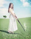 女孩射击了一个帽子 免版税图库摄影