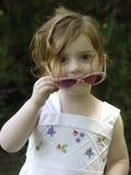 女孩小的太阳镜 图库摄影
