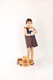 女孩小的玩具 免版税图库摄影