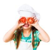 女孩小的蕃茄 免版税库存图片