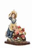女孩小雕象有独轮车的有很多花 免版税图库摄影