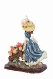 女孩小雕象有独轮车的有很多花 免版税库存照片