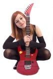 女孩少年吉他的纵向 图库摄影