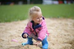 女孩少许使用的沙子 库存照片