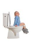 女孩少许坐的洗手间 图库摄影