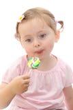 女孩少许棒棒糖 免版税图库摄影