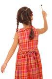 女孩少许油漆刷背面图 免版税图库摄影