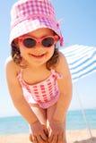 女孩少许海边 免版税库存图片