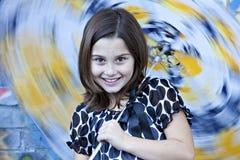女孩少许空转的伞 免版税库存照片