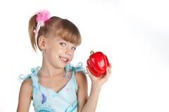 女孩少许胡椒红色甜点 免版税库存图片