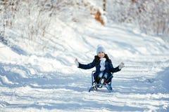 女孩少许雪橇 免版税图库摄影