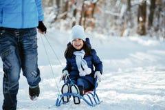 女孩少许雪橇 库存图片