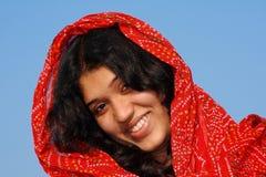 女孩巧妙她的红色的围巾 免版税库存照片