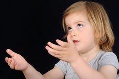 女孩希望孩子祈祷 免版税库存图片