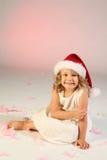 女孩帽子一点圣诞老人佩带 免版税库存照片