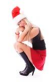 女孩帽子俏丽s圣诞老人亭亭玉立佩带 库存照片