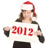 女孩帽子圣诞老人年轻人 免版税图库摄影