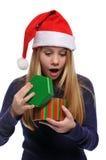 女孩帽子开张的当前s圣诞老人 免版税图库摄影