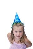 女孩帽子当事人佩带的年轻人 库存图片