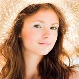女孩帽子微笑的秸杆 图库摄影