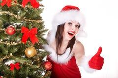女孩帽子显示略图的圣诞老人 免版税库存照片