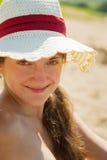 女孩帽子秸杆少年佩带 免版税库存照片