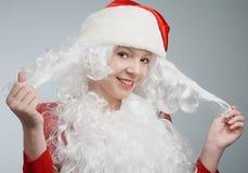 女孩帽子s圣诞老人 免版税库存照片