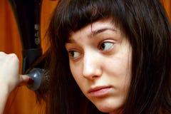 女孩干毛发 图库摄影