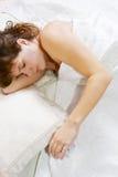 女孩平安休眠年轻人 库存图片