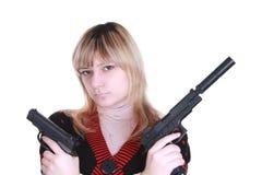 女孩开枪二个年轻人 库存照片