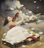 女孩弹的小提琴 库存照片