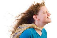 女孩微笑的风 库存图片