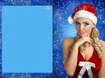 女孩性感的圣诞老人 免版税库存照片