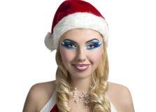 女孩性感的圣诞老人 免版税图库摄影